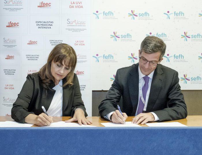 Firma del Convenio entre SEMICYUC y SEFH. De izquierda a derecha: Mª Cruz Martín (Presidenta de SEMICYUC) y Miguel Ángel Calleja (Presidente de SEFH)
